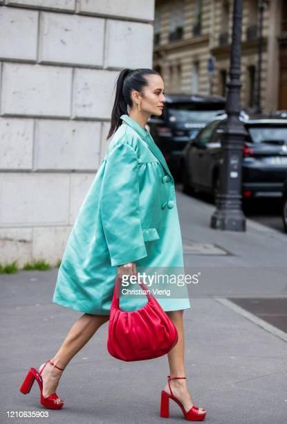 Anna Rosa Vitiello is seen wearing turquoise coat, red coat outside Miu Miu during Paris Fashion Week - Womenswear Fall/Winter 2020/2021 : Day Nine...