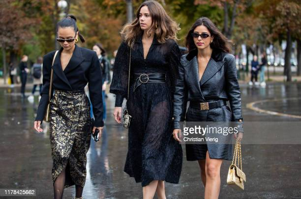 Anna Rosa Vitiello seen wearing black blazer, wrapped skirt with print, sheer tights Florrie Thomas wearing black sheer dress, Bettina Looney wearing...