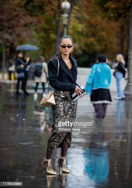 Anna Rosa Vitiello seen wearing black blazer wrapped skirt with print sheer tights golden heels outside Chanel during Paris Fashion Week Womenswear...