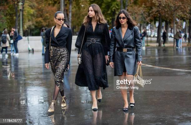 Anna Rosa Vitiello seen wearing black blazer, wrapped skirt with print, sheer tights, golden heels, Florrie Thomas wearing black sheer dress, Bettina...