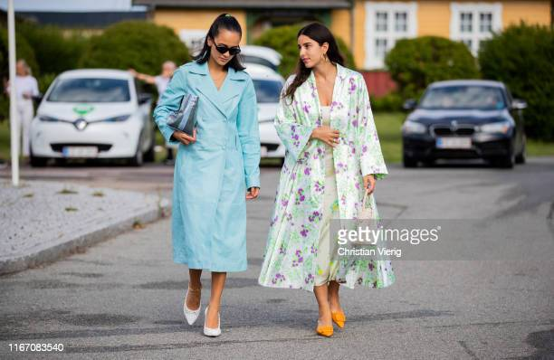 Anna Rosa Vitiello seen wearing turquois coat and Bettina Looney wearing coat with floral print, dress outside Stine Goya during Copenhagen Fashion...