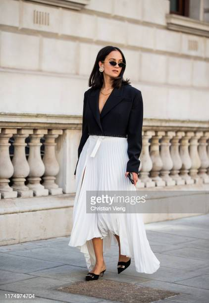 Anna Rosa Vitiello seen wearing white pleated skirt with slit, black blazer outside Victoria Beckham during London Fashion Week September 2019 on...
