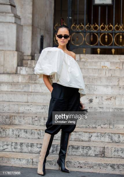 Anna Rosa Vitiello seen wearing white ripped off blouse, black pants, two tone boots outside Stella McCartney during Paris Fashion Week Womenswear...