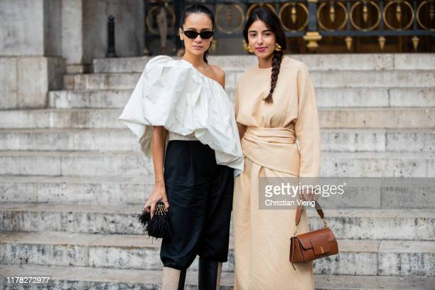 Anna Rosa Vitiello seen wearing white ripped off blouse, black pants, two tone boots and Bettina Looney wearing beige dress, brown bag outside Stella...