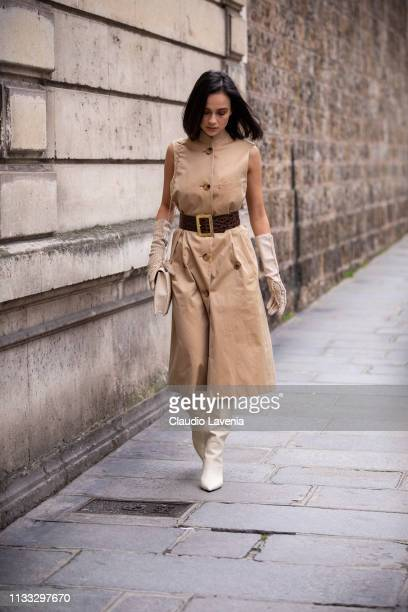 Anna Rosa Vitiello wearing a beige midi dress with brown belt cream gloves cream boots and cream bag is seen outside Elie Saab on Day 6 Paris Fashion...