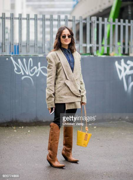 Anna Rosa Vitiello wearing brown boots seen outside Marques Almeida during London Fashion Week February 2018 on February 19 2018 in London England