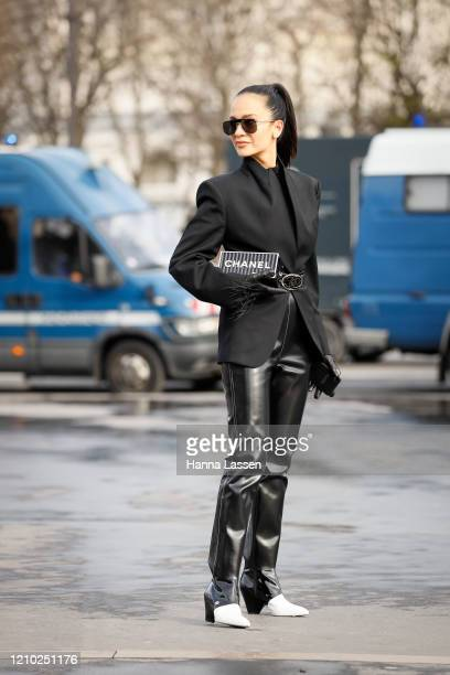 Anna Rosa Vitiello wearing Chanel clutch, black blazer, black leather pants and black and white leather shoes outside the Chanel show during Paris...
