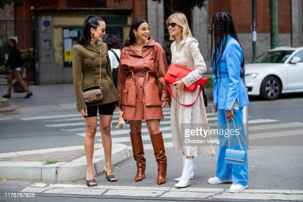 Anna Rosa Vitiello wearing cycle pants olive double breasted jacket Fendi bag Bettina Looney wearing rusty brown coat boots Xenia Adonts wearing red...
