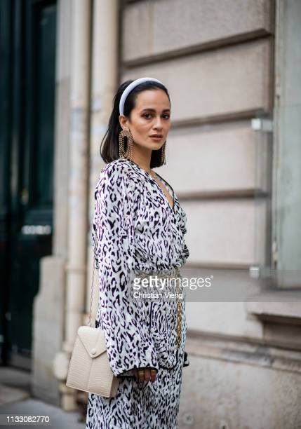 Anna Rosa Vitiello wearing hair loop, dress with animal print is seen during Paris Fashion Week Womenswear Fall/Winter 2019/2020 on March 01, 2019 in...