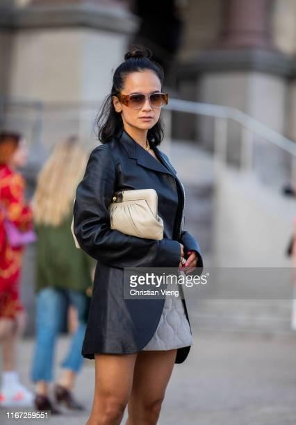 Anna Rosa Vitiello wearing leather jacket, mini skit, two tone boots outside Samsøe & Samsøe during Copenhagen Fashion Week Spring/Summer 2020 on...