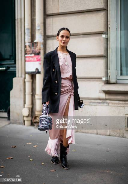 Anna Rosa Vitiello wearing pink silk dress with slit blazer is seen outside Alessandra Rich during Paris Fashion Week Womenswear Spring/Summer 2019...