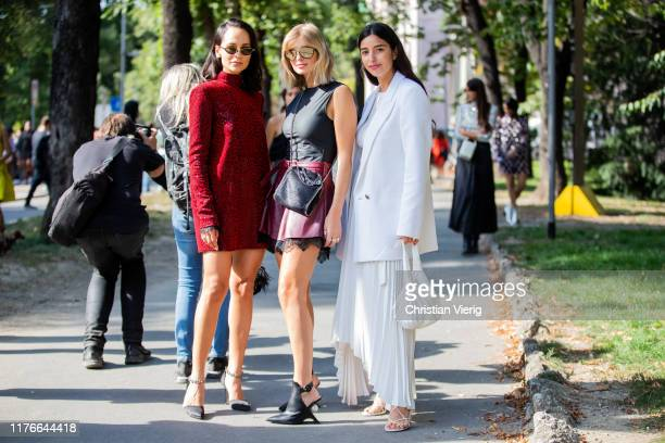 Anna Rosa Vitiello wearing red dress, Xenia Adonts wearing mini skirt, black top and Bettina Looney wearing white pleated skirt, blazer seen outside...