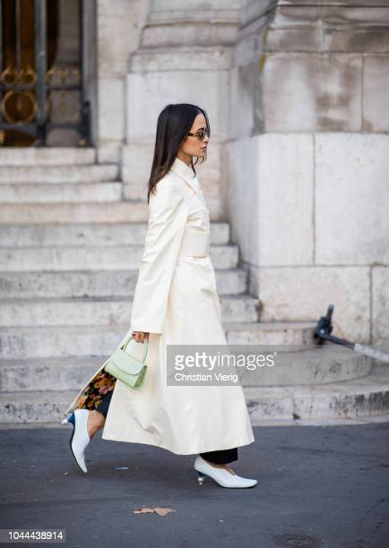Anna Rosa Vitiello wearing white creme trench coat is seen outside Stella McCartney during Paris Fashion Week Womenswear Spring/Summer 2019 on...