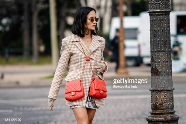 Anna Rosa Vitiello wears a blazer jacket double red Chanel bags outside Chanel during Paris Fashion Week Womenswear Fall/Winter 2019/2020 on March 05...