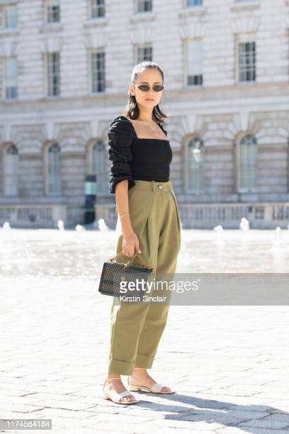 Anna Rosa Vitiello wears a Kurt Geiger bag, Reformation top, Maxine shoes, Topshop trousers and Linda Farrow sunglasses on September 13, 2019 in...