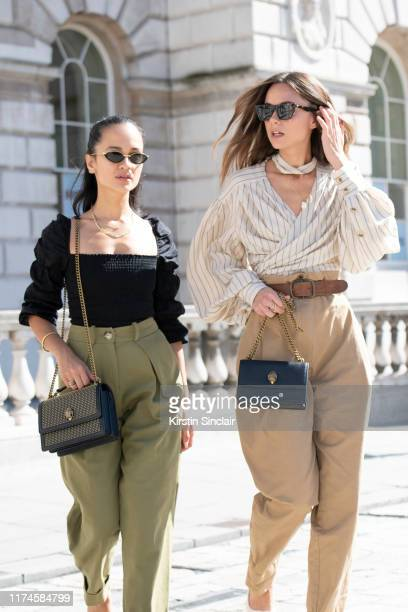 Anna Rosa Vitiello wears a Kurt Geiger bag, Reformation top, Topshop trousers and Linda Farrow sunglasses with Florrie Thomas wearing a Kurt Geiger...