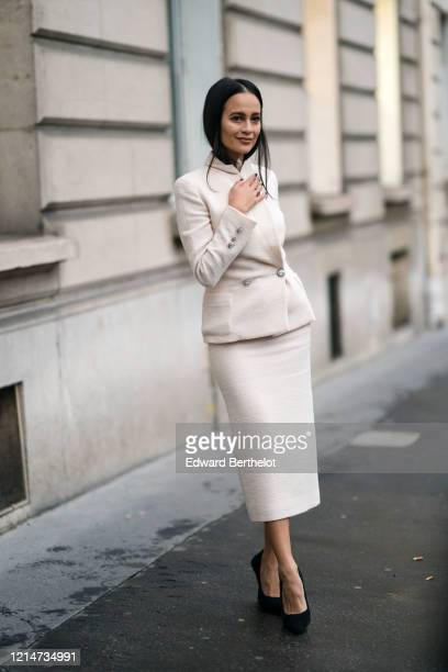 Anna Rosa Vitiello wears a white jacket with metallic buttons, a skirt, black shoes, outside Alessandra Rich, during Paris Fashion Week - Womenswear...