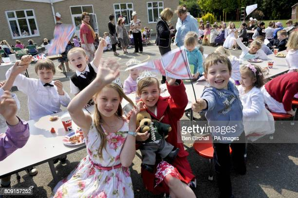 Anna Rose aged ten Lauren Smith aged ten and Jamie Dunstan aged five fly their handmade Union flags at the Bucklebury Church of England Primary...