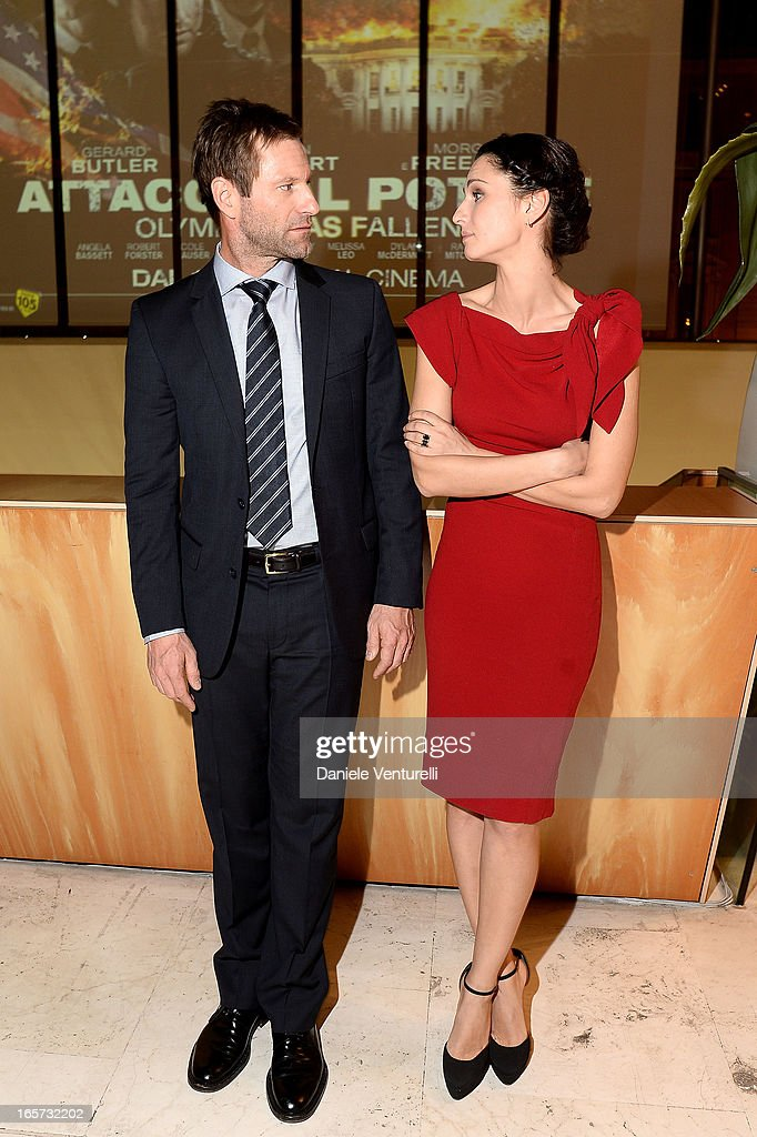 Anna Safroncik (R) and Aaron Eckhart attend a gala dinner by Antonello Colonna for the movie 'Olympus Has Fallen' on April 5, 2013 in Rome, Italy.