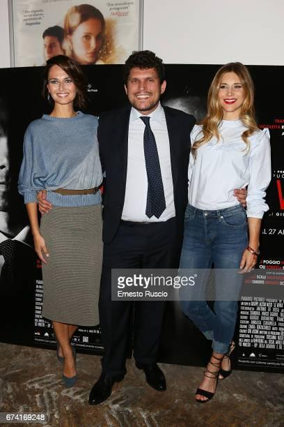 Anna Safroncik director Giuseppe Alessio Nuzzo and Nicoletta Romanoff attend a photocall for 'Le Verita' on April 27 2017 in Rome Italy