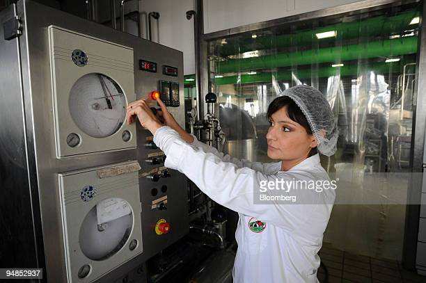 Anna Sannino checks milk temperature at the Baronia factory near Caserta north of Naples Italy on Friday April 11 2008 Sales of mozzarella from the...
