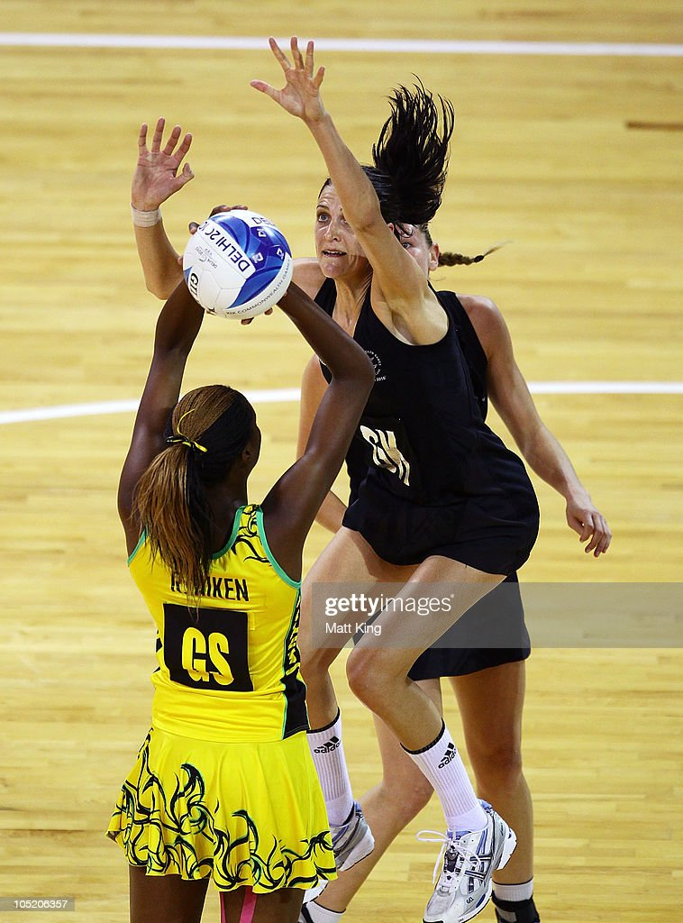 Anna Scarlett of New Zealand defends as Romelda Aiken of Jamaica shoots during the Women Semifinals Match between New Zealand and Jamaica at the Thyagaraj Sports Complex during day nine of the 2010 Commonwealth Games on October 12, 2010 in Delhi, India.
