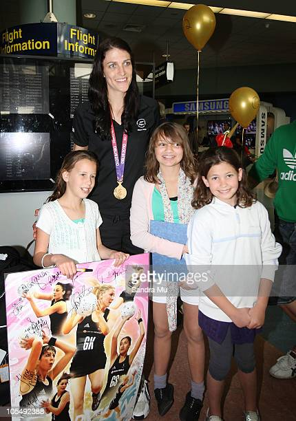 Anna Scarlett of the New Zealand Silver Ferns poses with fans as she arrives at Auckland International Airport on October 16 2010 in Auckland New...