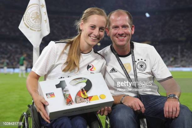 Anna Schaffelhuber is awarded as a new member of the Fan Club National Team Germany during the UEFA Nations League group A match between Germany and...