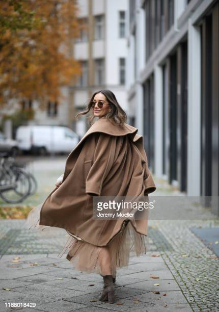 Anna Schürrle wearing a Max Mara coat, Gianvito Rossi heels and Dorothee Schumacher skirt on November 16, 2019 in Berlin, Germany.