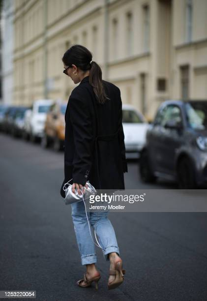 Anna Schürrle wearing Acne studios blazer Djerf Avenue shirt Bottega Veneta bag Citizen of humanity jeans and Gia heels on June 28 2020 in Berlin...