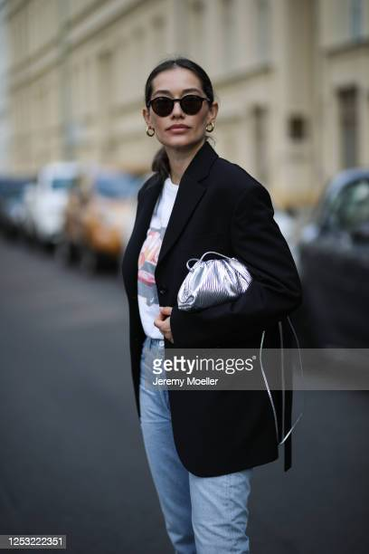 Anna Schürrle wearing Acne studios blazer Djerf Avenue shirt Bottega Veneta bag and a Citizen of humanity jeans on June 28 2020 in Berlin Germany