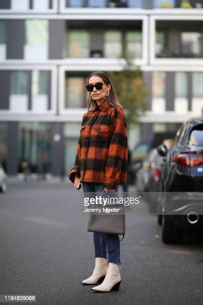 Anna Schürrle wearing Aeyde boots HM jeans Hermès bag Anine Bing jacket Celine earrings and Bottega Veneta sunglasses on October 31 2019 in Berlin...