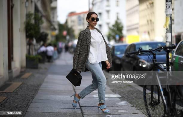 Anna Schürrle wearing Anine Bing jacket black leather Hermes bag blue Bottega Veneta heels Anine Bing white shirt and Citizen of Humanity blue jeans...