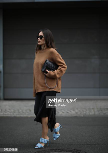 Anna Schürrle wearing Anine Bing sweater and skirt Balenciaga shades Bottega Veneta heels and Chanel bag on June 28 2020 in Berlin Germany
