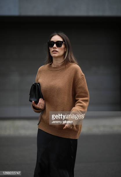 Anna Schürrle wearing Anine Bing sweater and skirt Balenciaga shades and Chanel bag on June 28 2020 in Berlin Germany