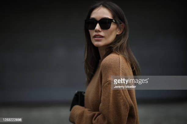 Anna Schürrle wearing Anine Bing sweater Balenciaga shades and Chanel bag on June 28 2020 in Berlin Germany