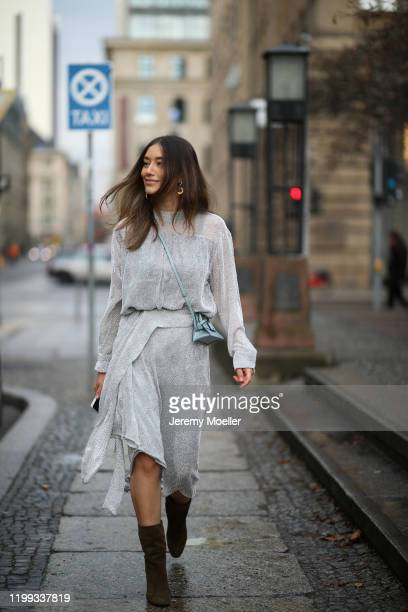 Anna Schürrle wearing Balenciaga earring and sunglasses, top and skirt from Lala Berlin, Aquazurra heels and a Boyy bag during the Berlin Fashion...