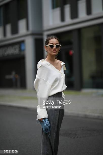 Anna Schürrle wearing Bottega Veneta bag Alexander Wang blouse Max Mara pants and Celine shades on June 28 2020 in Berlin Germany