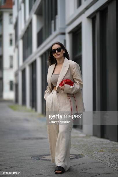 Anna Schürrle wearing Bottega Veneta bag and shoes, Balenciaga shades and by Aylin Koenig Suit and Top on June 28, 2020 in Berlin, Germany.