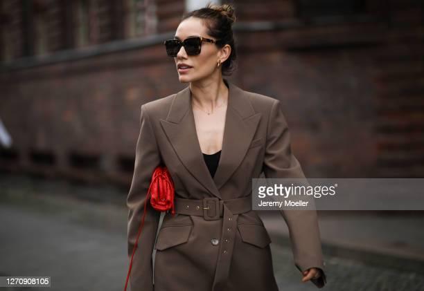Anna Schürrle wearing Bottega Veneta red bag and Nanushka blazer on September 04, 2020 in Berlin, Germany.