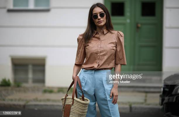 Anna Schürrle wearing Bottega Veneta shades Gestuz blouse Max Mara pants and Loewe bag on June 28 2020 in Berlin Germany