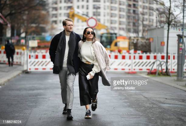 Anna Schürrle wearing Bottega Veneta sunglasses and belt, Balenciaga Triple S sneaker, H&M pants, Bite Studios sweater and American Vintage coat and...