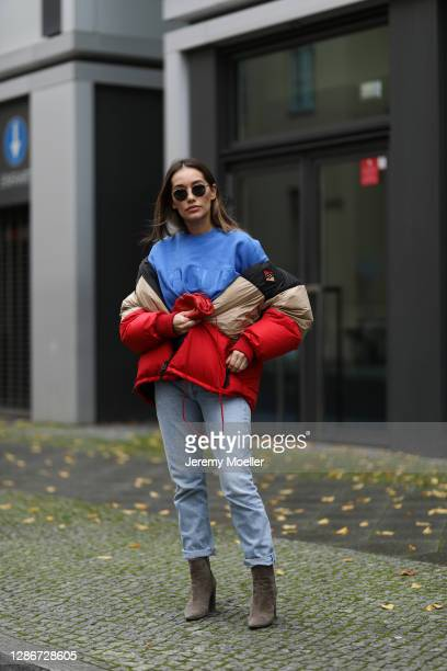 Anna Schürrle wearing Burberry puffer jacket, Gianvito Rossi boots, Thome Browne shades and Citizens of Humanity jeans, blue Vogue sweater and red...