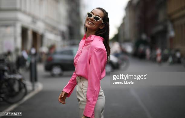 Anna Schürrle wearing Celine shades Les Coyotes de Paris blouse and pants and Ulla Johnson bag on July 17 2020 in Berlin Germany
