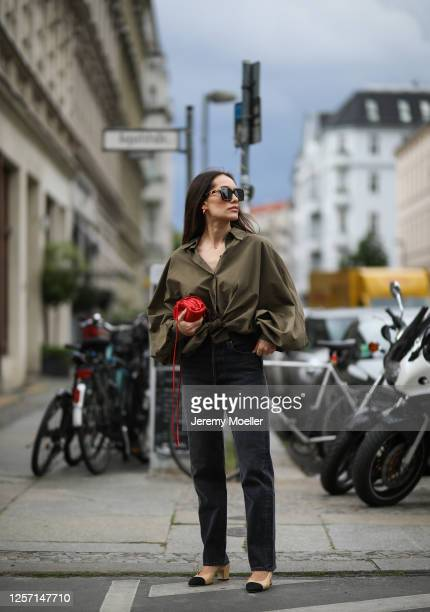 Anna Schürrle wearing Chanel heels, Bottega Veneta shades and bag, Agolde jeans and Sosue blouse on July 17, 2020 in Berlin, Germany.