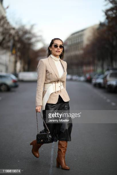 Anna Schürrle wearing complete Marc Cain look, Chanel bag and Cultgaia belt during the Berlin Fashion Week Autumn/Winter 2020 on January 14, 2020 in...