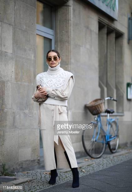 Anna Schürrle wearing Cult Gaia earrings, Isabel Marant Etoile shirt, Isabel Marant vest, Nanushka skirt, Gianvito Rossi heels, Max Mara bag and...