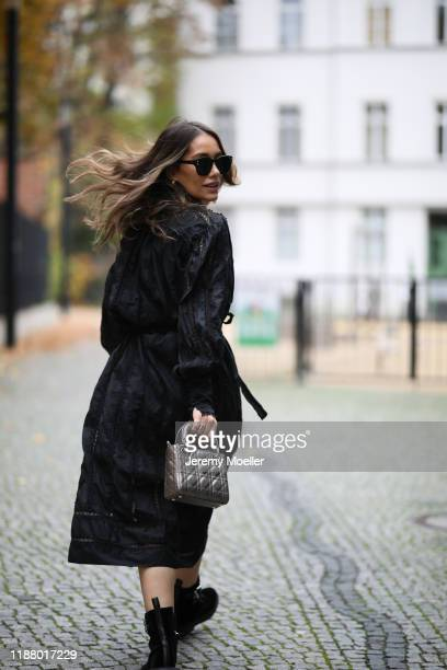 Anna Schürrle wearing Dior bag and sunglasses Dorothee Schumacher turtleneck Tods boots and Zimmermann dress on November 16 2019 in Berlin Germany