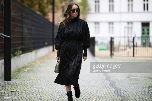 Anna Schürrle wearing Dior bag and sunglasses, Dorothee Schumacher turtleneck, Tods boots and Zimmermann dress on November 16, 2019 in Berlin,...