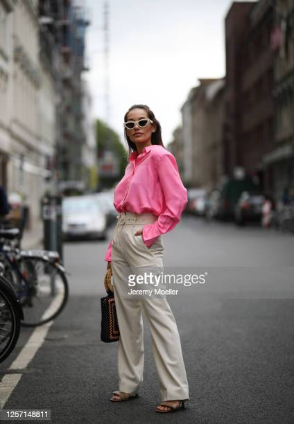 Anna Schürrle wearing Gia heels, Celine shades and Les Coyotes de Paris blouse and pants and Ulla Johnson bag on July 17, 2020 in Berlin, Germany.